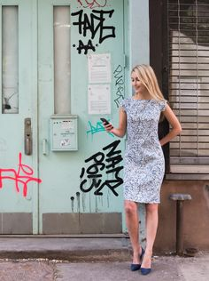 Blair, taking care of business in the Sarah Indigo Marble. #spring #prints #weartowork #workwear #blueandwhite #springdress