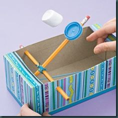 """a """"simple machine"""" think of ways to test it. What matters for distance-weight of item, thickness of elastic, length of elastic, how far you pull pencil back? How accurate can you be? Can tie this in with Medieval Unit"""