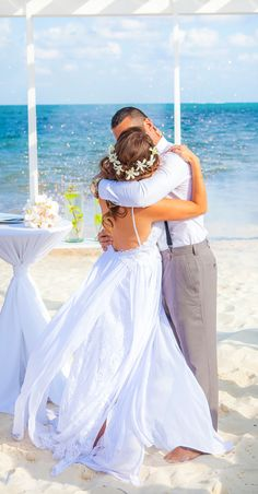 We LOVE the flow to this beach wedding dress as bride and groom share their first kiss on the beach. (Wedding photography by Fun In The Sun Weddings) http://www.funinthesunweddings.com