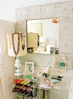 The mirror gave me the idea to frame up a faux tin ceiling panel and layer a mirror in the center.  For master bath?