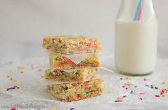 Funfetti Bars   Cake batter flavored anything is delicious and these cake batter blondies are no different.  These bars are buttery, chewy, gooey.  The rainbow sprinkles add a festive and fun touch to this hand held treat.  @tasteandtell