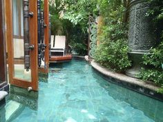 Literally walking into your pool. A tiny backyard converted into a swimming pool. Epic.