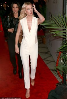 Strutting her stuff: January completed her chic red carpet outfit with the addition of a p...