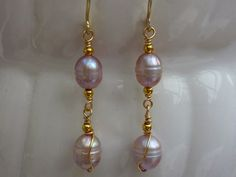Earrings: champange ear wires and freshwater pearls in pale lilac. £6.00, via Etsy.