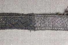 "Bj 965. The original Birka brocaded tablet woven band no. B 6. Double silver thread. Note the borders. Add 3 (more like 4 or even 5) tablets each side to the design provided by Geijer in ""Birka III"", p. 83. (to see the biggest picture click ""Stor"" under the image on Historiska.se)"