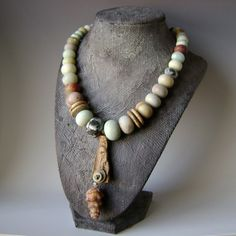 Desert Breeze necklace by AnvilArtifacts. notice the display, how it accents and matches the style of the item