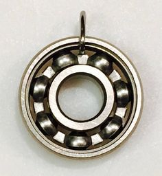 Love Derby Girl Designs but more a fan of minimalism and not bright colors? Just get a plain wheel bearing pendant with no gemstone and problem solved! #derbygirldesigns #bearingjewelry #jewelrythatrocks #minimalism