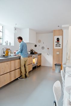 concrete and wood kitchen with white walls
