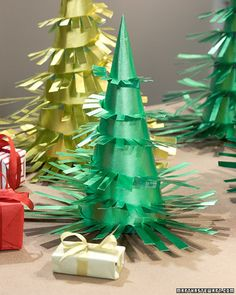 Use decorative wrapping paper in festive colors to make an entire Yuletide forest for the mantle or dining table.Print the Christmas Tree Template