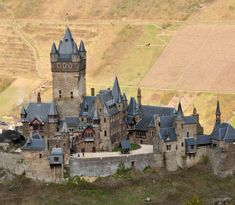 Reichsburg Cochem (Imperial Castle, Cochem) - The castle we see today towering above the scenic town of Cochem on the Moselle River is not the castle that originally stood there in the 12th century. That castle had a long and colorful history until French King Louis XIV had his troops obliterate it in 1689.