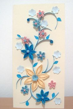 """jucarie pe zi: Flori - quilling"" ..... I think the plain pale blue flowers add some relief & highlight rest of the exquisite quilling."