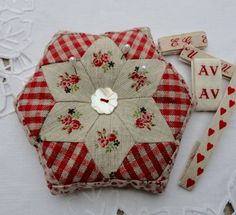 Pincushion. Gingham is nice complemented by the rose fussy cutting.