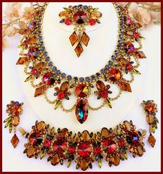 Apache Summer - 2008  DiMartino Originals is the signature of a Tennessee artist who has been making jewelry for more than 20 years. She taught herself the almost-lost art of costume jewelry making; combining it with her copious artistic talent, she has created some of the most beautiful rhinestone jewelry. She uses primarily Swarovski Austrian crystal rhinestones, vintage and hand-painted cabochons, many of which are no longer being made.