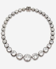 Chaumet - An important antique silver, yellow gold and diamond rivière necklace, mid-19th century. Designed as a series of 37 cushion/oval diamonds graduating in size, the clasp set with four smaller diamonds. With maker's mark. #Chaumet #antique