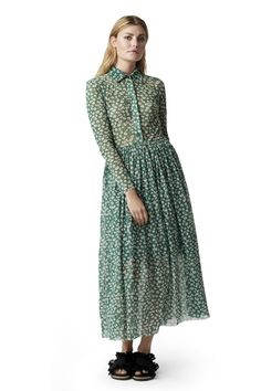 Maxi shirt dress featuring a transparent top, a  clinging waist and button placket. <br /><br />Model is  175cm tall and wearing a size small/ 36.