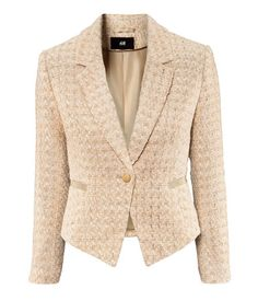 H - Short, fitted jacket in textured fabric with glittery threads. Features welt pockets and single gold-colored front button. Lined.