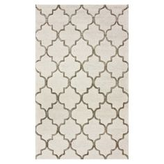 Anchor vibrant decor or bring a pop of pattern to neutral palettes with this hand-tufted wool and art silk rug, showcasing a classic quatrefoil trellis motif...