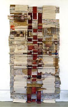 Giordano's large constructions, which hang on the wall, incorporate other found paper and corrugated cardboard that she tears and burns to create jagged, charred edges, as well as graphite, paint and encaustic, all interwoven with the newspapers to create an unusual irregular abstract tapestry.