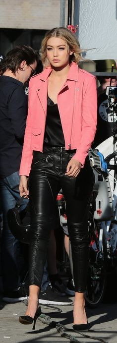 Gigi Hadid in leather pants and a pink biker jacket