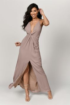 Get showered in compliments all night in the Eyes on You Knotted Taupe Maxi Dress. This plunge drape dress has a sophisticated deep v neckline and tin Beige Maxi Dresses, Dusty Blue Bridesmaid Dresses, Taupe Dress, Dresses Elegant, Sexy Dresses, Taupe Bridesmaid, Ruffle Dress, Party Dresses, Women's Fashion Dresses