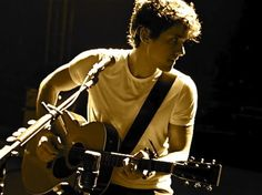 John Mayer...I would do anything to see him in concert.