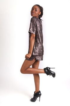 PEWTER METALLIC SHORT SUIT R - All over metallic detail - Box shape top - Short sleeves - Round neckline - Zip detail on back of top - Draw string fastening on shorts - Elasticated waistband - Mini length Metallic Shorts, Short Suit, Pewter Metal, Shirt Dress, T Shirt, Short Sleeves, Neckline, Draw, Shape