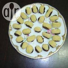 Kokos-gefüllte Trockenpflaumen (Olho de sogra) aus Brasilien, brasilianisches Dessert, brasilianisch, Essen, Brasilien. Rezept: http://de.allrecipes.com/rezept/17162/kokos-gef-llte-trockenpflaumen--olho-de-sogra-.aspx