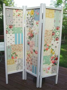 A screen decorated with lovely scrap-booking paper...