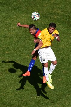 Alexis Sanchez Photos Photos - Alexis Sanchez of Chile and Thiago Silva of Brazil go up for a header during the 2014 FIFA World Cup Brazil round of 16 match between Brazil and Chile at Estadio Mineirao on June 28, 2014 in Belo Horizonte, Brazil. - Brazil v Chile: Round of 16 - 2014 FIFA World Cup Brazil