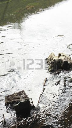 Picture of Water way polluted with an old shopping trolley, tires, and various other items stock photo, images and stock photography. Water Pictures, Music Files, Tired, Royalty, Stock Photos, Photography, Outdoor, Inspiration, Shopping