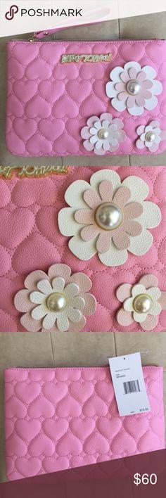 Betsey Johnson blush / light pink daisy wristlet Betsey Johnson blush / light pink daisy wristlet. NWT. Length is 11 1/4 inches. Height 8 inches. Betsey Johnson Bags