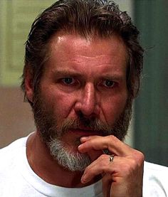 "Dr. Richard Kimble  (Harrison Ford)  is falsely accused of murdering his wife in the 1993 movie ""The Fugitive"""