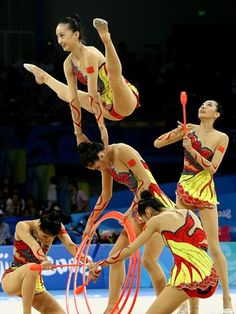 The Chinese team performs in the Beijing 2008 Games - The Chinese team perform in the 3 Hoops and 2 Clubs rotation in the Group All-Around Final held at the Beijing University of Technology Gymnasium during Day 16 of the Beijing 2008 Olympic Games.