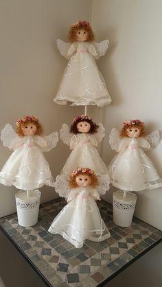 Centros de mesa con ángeles para bautizo de niña