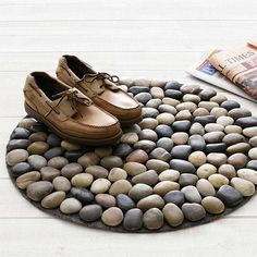 Natural stone pebble mosaic is an easy way to create your own unique home décor accents. As an alternative to bought mosaic tiles, it's nice to collect pebbles and river rocks and make your own accessories.