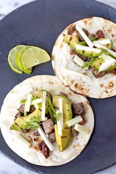 Steak Tacos with Cucumber-Jicama Salsa - These simple tacos with warm flour tortillas topped with spicy and crunchy cucumber-jicama salsa and grilled avocado slices are delcious anytime of year.
