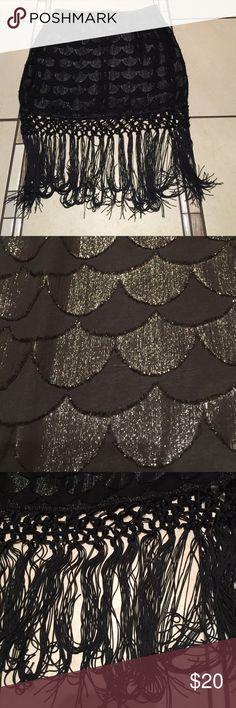 Akira fringe skirt Used once and in good condition. Akira black fringe skirt AKIRA Skirts