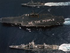 """Crew members form the phrase """"We The People"""" on the flight deck of the aircraft carrier USS RANGER (CV 61) to commemorate the 200th anniversary of the signing of the constitution of the United States."""