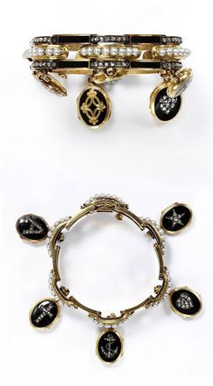 "The Cory Mourning Bracelet, 1860, Cory Bequest Crouzet. The Victoria & Albert Museum. He is especially well known for designing pieces in the Moroccan taste. This bracelet is a piece of mourning jewellery in traditional black enameled gold, pearls & brilliant cut diamonds. It is hung w/ 5 small lockets, each of which opens to allow for a photo or lock of hair. The lockets are set with diamonds in the form of images: a cross, anchor, heart & the initial, ""A."" Read More..."