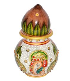 Ivory Subh Puja kalash with nariyal. This is decorative item to give auspicious look to your mandir. - See more at: http://potofgoodies.com/marble-subh-puja-kalash-64836721