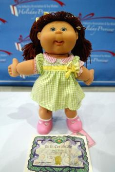 The Story Behind the Cabbage Patch Buying Frenzy of 1983: A new Cabbage Patch Kids doll is displayed at the Toy Industry Association