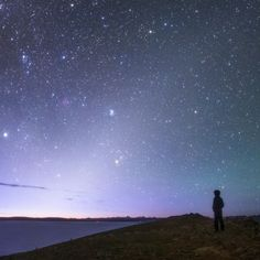 Zodiacal light. Photo by Jeff Dai. Zodiacal light or false dawn, is light a couple of hours before sunrise and is caused by light reflected off of dust particles.
