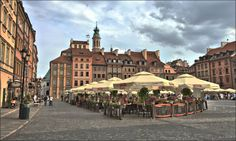 https://flic.kr/p/LHJCGg | Rynek Starego Miasta | Old Town Warsaw's Market Square--a splendid place to enjoy a beer on a summer afternoon.  The entire Old Town district was completely destroyed during World War II.  Its painstaking and faithful restoration, often based on paintings that survived the war, is testament to the resiliency of the Polish people, who have suffered mightily at the hands of their neighbors invading from every direction over the centuries.