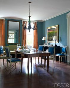 Julia Reed and John Pearce's home in New Orleans, from Elle Decor (September 2012) -- The dining room's Federal table is surrounded by painted Louis XVI chairs; the chandelier is Rococo Revival, the mirror is late-18th-century French, the curtains are of a Claremont silk, and the walls are painted in Benjamin Moore's Fort Pierce Green. Photo by William Waldron.