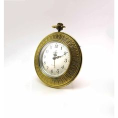 Linden Round Brass Alarm Clock Leaf or Feather Motif Made in Germany... ($18) ❤ liked on Polyvore featuring home, home decor, clocks, brass clock, brass home decor, leaf home decor and brass alarm clock