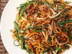 Quick and easy stir-fried lo mein noodles with cabbage charred until sweet, sauteed mushrooms, and Chinese chives in a light sauce.