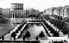Stockholm Stadsbibliotek (City Library) and it's park and 'plaskdamm' (wading pool, or literally, splashing pool), by architect Gunnar Asplund. Photographed shortly after its construction in 1928.