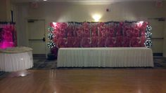 Undos Catering Hall in West Virginia use 5 art print screens of roses as a beautiful backdrop focal point by the dance floor.  They added their own accent lighting as well for the cool effect.  Very creative!