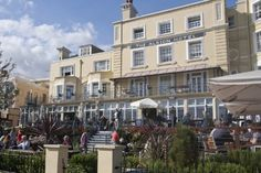 (PHOTO: The Royal Albion)  Beautiful pub gardens around Britain:   The Royal Albion, Kent  This 18th century seafront pub and hotel in Broadstairs was a favourite haunt of Charles Dickens and we can see why as it offers lovely sea views from its unrivalled position in the middle of the town. The large terrace and garden overlooking Viking Bay is perfect for relaxing by the beach on a summer day while sipping Shepherd Neame ale and smelling the salty air. There's a pleasant conservatory-style