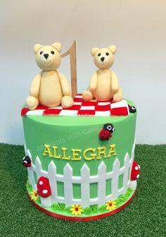 Teddy bears picnic themed birthday cake. Cake was made of chocolate mud. Fondant teddy bear toppers.